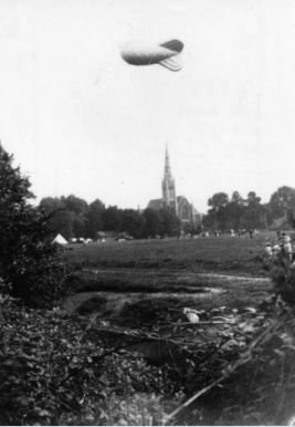 Roath Park in WWII with church in background and barrage ballloon
