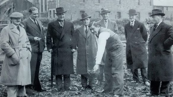 Maurice turns the turf as the foundations are laid in 1936 for the Cardiff Squash Club. He is watched by, from left to right Gerald Turnball
