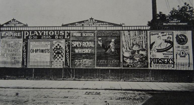 Billboards on Newport Rod, Cardiff in the 1920s opposite the bus depot