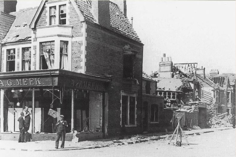 A G Meek on corner of Albany Road and Angus Street following the bombing in September 1940